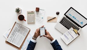 Tax Fraud Whistleblower Reward: Business person at a desk.