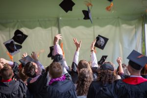 Student Loan Fraud Whistleblower Reward: Students celebrating at graduation.